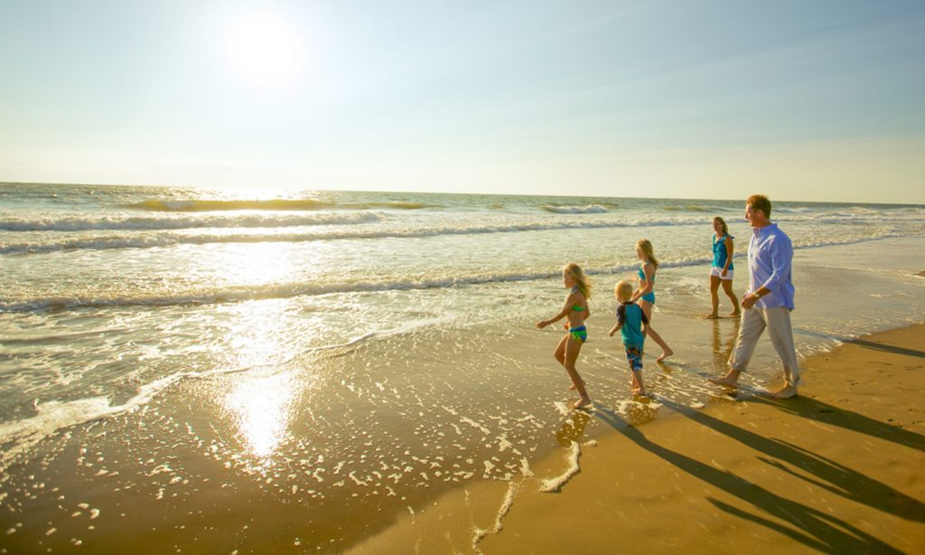 Virginia Beach events, a family enjoying the beach view, 3 girls a boy with dad.